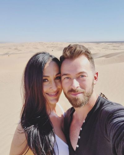 23 Weeks! Artem Chigvintsev Holds Nikki Bella's Growing Baby Bump in Sweet Photo: We're 'on Cloud 9'