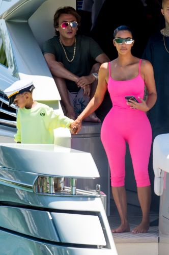 Kim Kardashian's Hot Pink Chanel Onesie Is a Sight to Behold