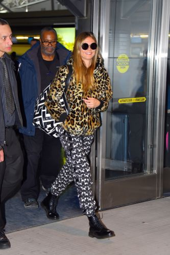 Heidi Klum Wore the Most Maximalist Airport Outfit We've Ever Seen