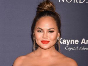 Chrissy Teigen Just Debuted Her Baby Bump With The Most Hilarious Caption Ever