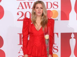 This Is Why Celebrities Are Carrying Roses On The BRITs Red Carpet