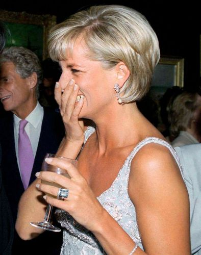 The Incredible Story Behind Meghan's Gigantic Ring From Princess Diana