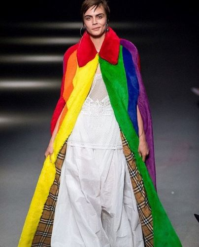 Cara Delevingne closed Burberry in a giant rainbow cape