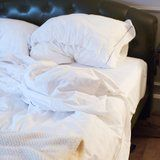 You Should Be Washing Your Pillowcase Way More Often Than You Think to Avoid Acne