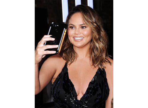 Chrissy Teigen Trolled the Victoria's Secret Fashion Show and It Will Make Your Day
